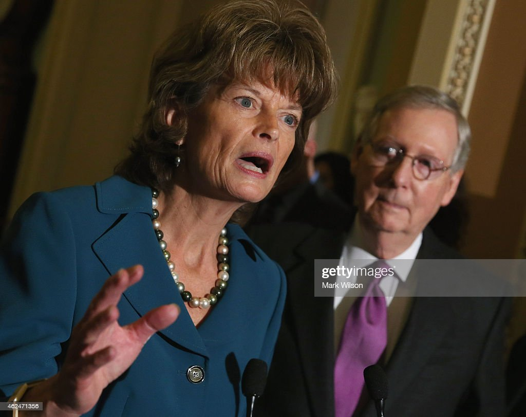 Sen Lisa Murkowski speaks while flanked by Sen Majority Leader Mitch McConnell on January 29 2015 at the US Capitol in Washington DC The US Senate is...