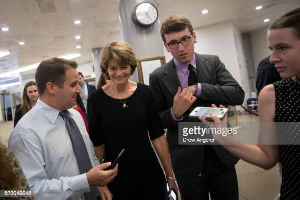 Sen Lisa Murkowski talks to reporters as she walks through the Senate subway on her way to an amendment vote on the GOP heath care legislation on...