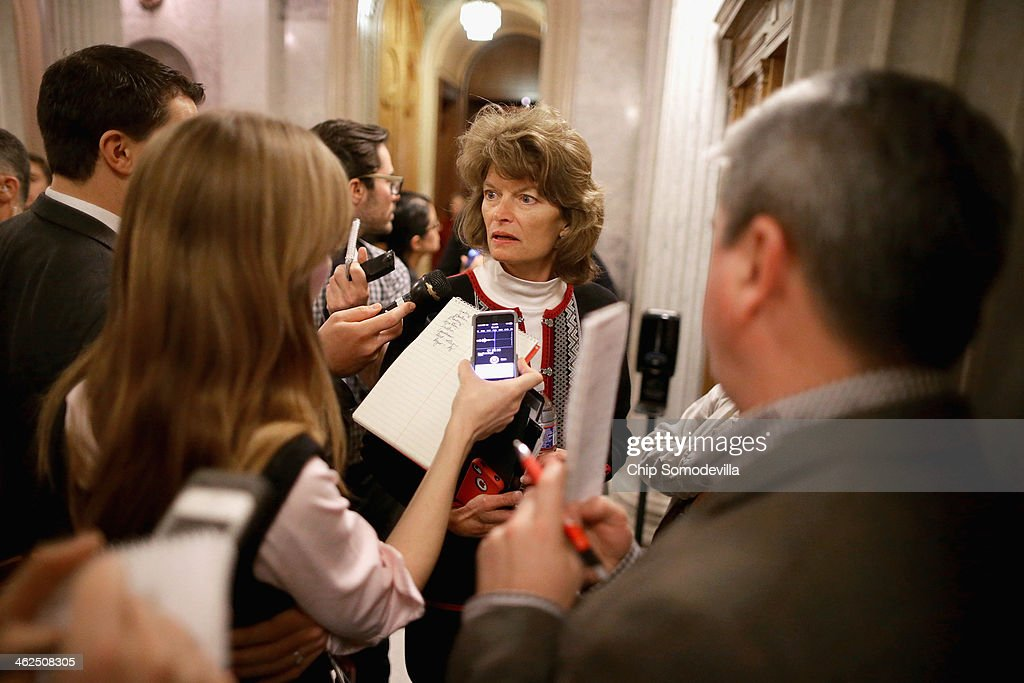 Sen Lisa Murkowski talks to reporters during the vote for the confirmation of Robert Leon Wilkins to be US circuit judge for the DC Circuit at the US...