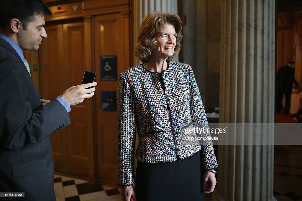 Sen. <a gi-track='captionPersonalityLinkClicked' href=/galleries/search?phrase=Lisa+Murkowski&family=editorial&specificpeople=3134392 ng-click='$event.stopPropagation()'>Lisa Murkowski</a> (R-AK) talks with reporters before attending the weekly Republican Senate caucus policy luncheon at the U.S. Capitol November 5, 2013 in Washington, DC. The Senate overcame a procedural hurdle Monday to move closer to passage of the Employment Non-Discrimination Act of 2013, which would outlaw workplace discrimination based on sexual orientation and gender identity.