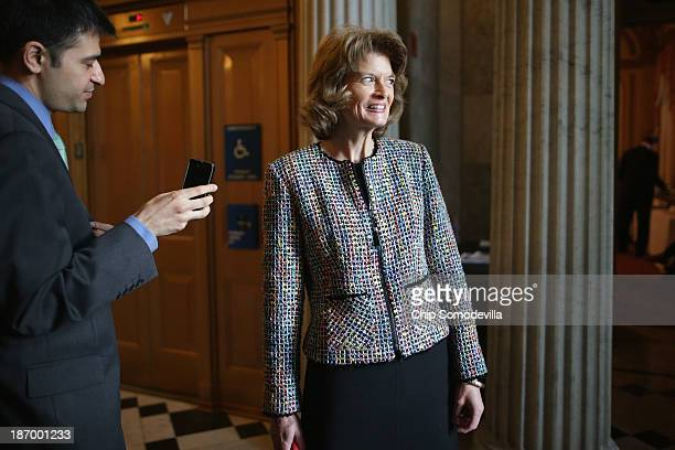 Sen Lisa Murkowski talks with reporters before attending the weekly Republican Senate caucus policy luncheon at the US Capitol November 5 2013 in...