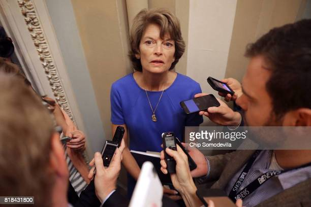Sen Lisa Murkowski talks with reporters before attending the weekly Senate Republican policy luncheon outside the Mansfield Room at the US Capitol...