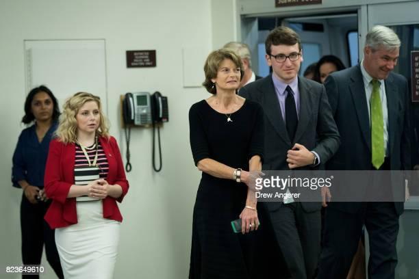 Sen Lisa Murkowski walks through the Senate subway on his way to an amendment vote on the GOP heath care legislation on Capitol Hill July 27 2017 in...