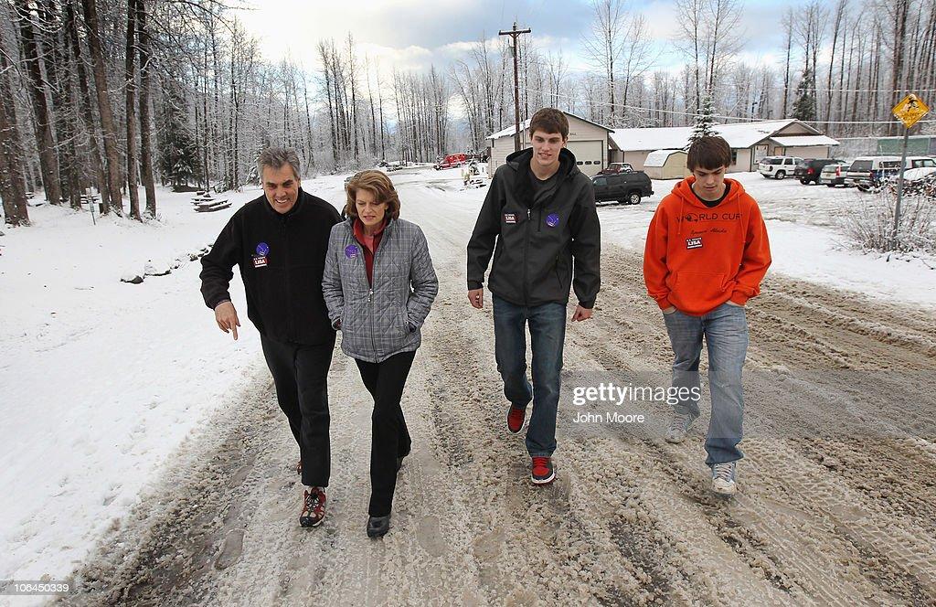 S Sen Lisa Murkowski walks with her husband Verne Martell and sons Nick and Matt Martell after voting on November 2 2010 in Girdwood Alaska Murkowski...