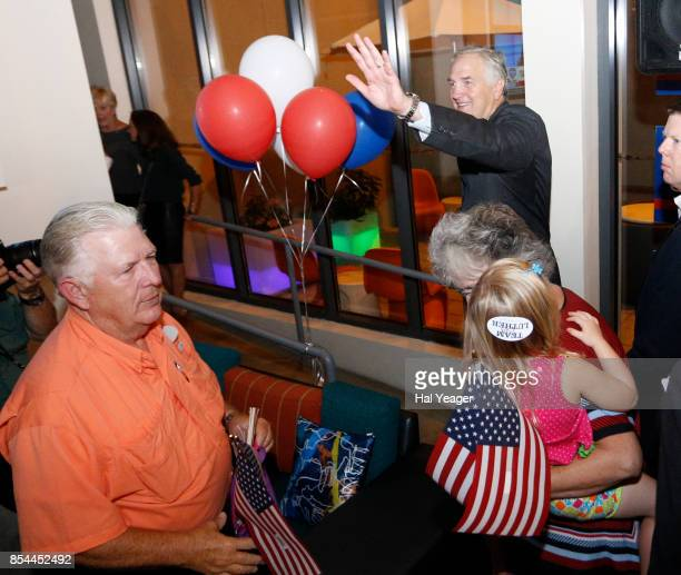 Sen Luther Strange waves to supporters as he leaves after making his concession speech after losing to Roy Moore in a GOP runoff election on...