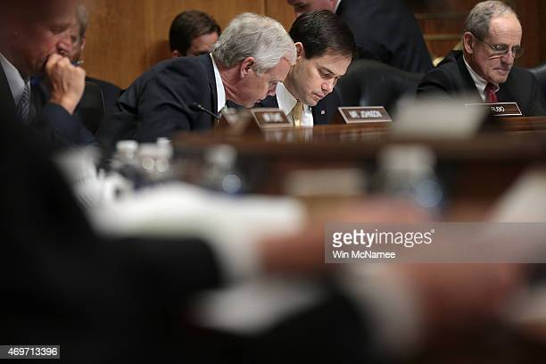 Sen Marco Rubio a Republican presidential candidate confers with Sen Ron Johnson during a markup meeting of the Senate Foreign Relations Committee on...