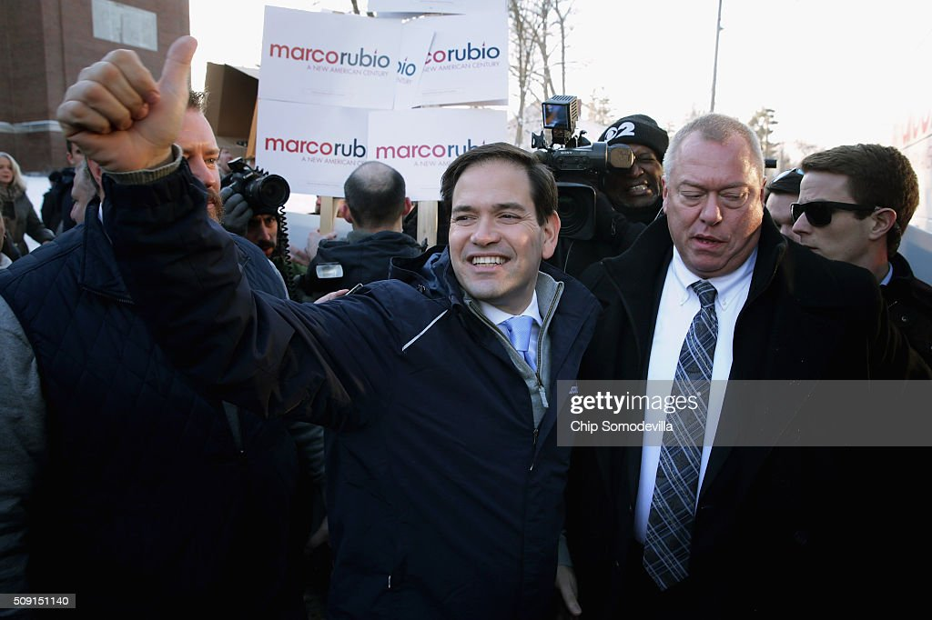 Sen. <a gi-track='captionPersonalityLinkClicked' href=/galleries/search?phrase=Marco+Rubio+-+Politicus&family=editorial&specificpeople=11395287 ng-click='$event.stopPropagation()'>Marco Rubio</a> (R-FL) boards his campaign bus after stopping to thank supporters outside the polling place outside Webster School February 9, 2016 in Manchester, New Hampshire. With a good showing in the Iowa caucuses, Rubio has stepped into the crosshairs of fellow Republicans running for president and super PACs that want to slow his momentum with attacks on what they call his robotic and repetative messaging.
