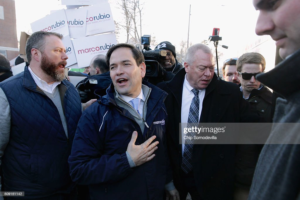 Sen. <a gi-track='captionPersonalityLinkClicked' href=/galleries/search?phrase=Marco+Rubio+-+Politiker&family=editorial&specificpeople=11395287 ng-click='$event.stopPropagation()'>Marco Rubio</a> (R-FL) boards his campaign bus after stopping to thank supporters outside the polling place outside Webster School February 9, 2016 in Manchester, New Hampshire. With a good showing in the Iowa caucuses, Rubio has stepped into the crosshairs of fellow Republicans running for president and super PACs that want to slow his momentum with attacks on what they call his robotic and repetative messaging.