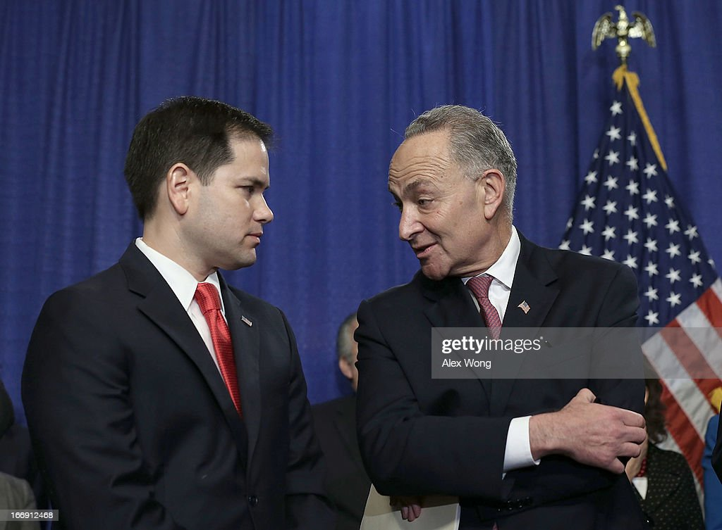 U.S. Sen. <a gi-track='captionPersonalityLinkClicked' href=/galleries/search?phrase=Marco+Rubio+-+Politician&family=editorial&specificpeople=11395287 ng-click='$event.stopPropagation()'>Marco Rubio</a> (R-FL) (L) listens to Sen. Chuck Schumer (D-NY) during a news conference on immigration reform April 18, 2013 on Capitol Hill in Washington, DC. The senators discussed the 'Border Security, Economic Opportunity, and Immigration Modernization Act'.