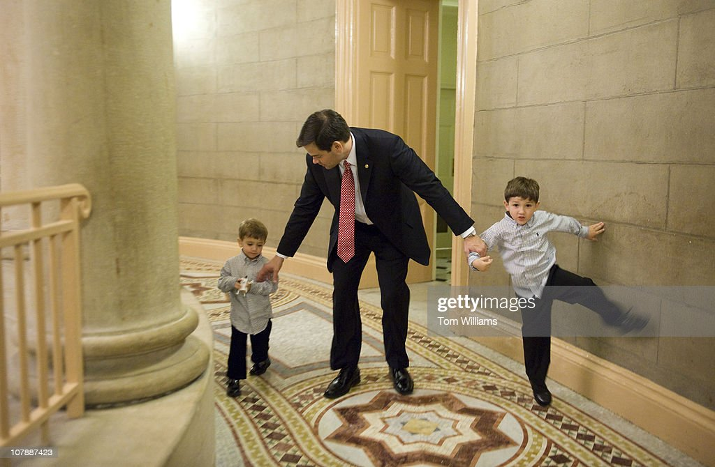 Sen. Marco Rubio, R-Fla., and his sons Anthony, 5, right, and Dominic, 3, make their way to a swearing in ceremony for the 112th Congress in the Old Senate Chamber. The Senators were sworn in on the Senate floor and then proceeded to the Old Senate Chamber for a mock swear in.