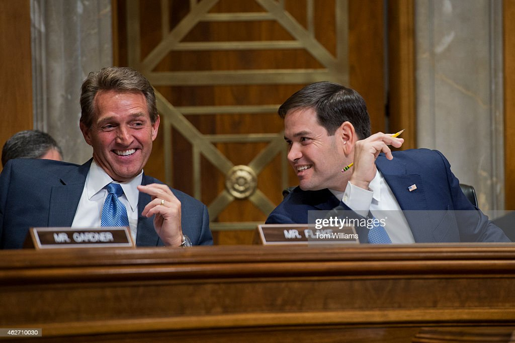 Sen. <a gi-track='captionPersonalityLinkClicked' href=/galleries/search?phrase=Marco+Rubio+-+Politicus&family=editorial&specificpeople=11395287 ng-click='$event.stopPropagation()'>Marco Rubio</a>, R-Fla., chairman, and Sen. <a gi-track='captionPersonalityLinkClicked' href=/galleries/search?phrase=Jeff+Flake&family=editorial&specificpeople=2474871 ng-click='$event.stopPropagation()'>Jeff Flake</a>, R-Ariz., share a laugh during a Senate Foreign Relations subcommittee hearing in Dirksen Building titled 'Understanding The Impact of U.S. Policy Changes On Human Rights And Democracy In Cuba,' February 3, 2015.