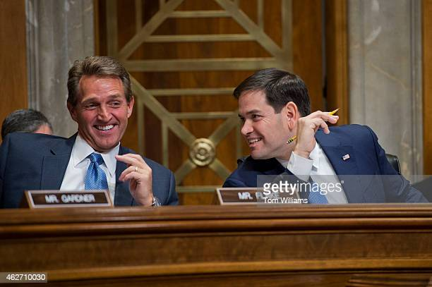 Sen Marco Rubio RFla chairman and Sen Jeff Flake RAriz share a laugh during a Senate Foreign Relations subcommittee hearing in Dirksen Building...