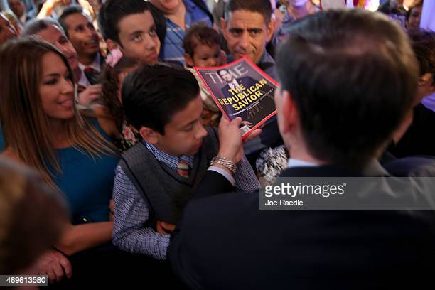 S Sen Marco Rubio signs a Time magazine given to him as he greets people after announcing his candidacy for the Republican presidential nomination...