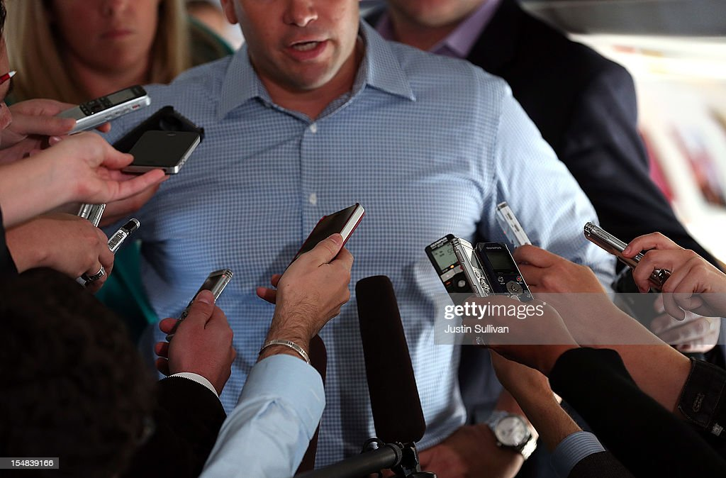 U.S. Sen. Marco Rubio speaks to reporters on the campaign plane of Republican presidential candidate, former Massachusetts Gov. Mitt Romney on October 27, 2012 en route to Orlando, Florida. With less than two weeks before election day, Mitt Romney is campaigning in Florida.