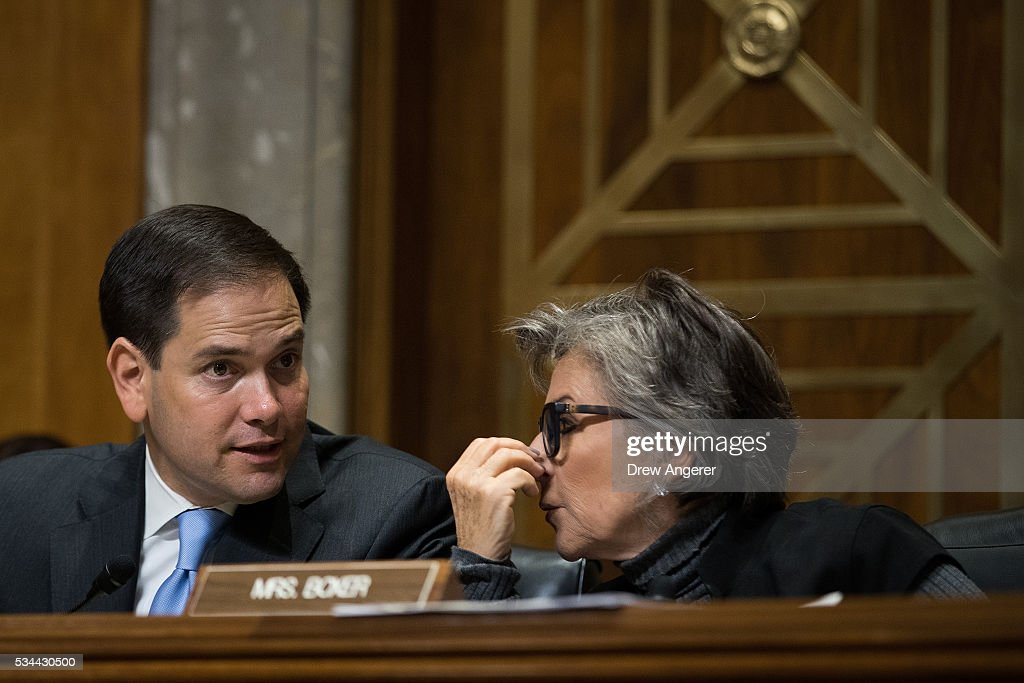 Sen. <a gi-track='captionPersonalityLinkClicked' href=/galleries/search?phrase=Marco+Rubio+-+Politician&family=editorial&specificpeople=11395287 ng-click='$event.stopPropagation()'>Marco Rubio</a> (R-FL) speaks with Sen. <a gi-track='captionPersonalityLinkClicked' href=/galleries/search?phrase=Barbara+Boxer&family=editorial&specificpeople=169888 ng-click='$event.stopPropagation()'>Barbara Boxer</a> (D-CA) during a Senate Foreign Relations Committee hearing concerning cartels and the U.S. heroin epidemic, on Capitol Hill, May 26, 2016, in Washington, DC. According to the U.S. Centers for Disease Control and Prevention, from 2002 to 2013 the rate of heroin-related deaths quadrupled in the United States, with most of the increase coming after 2010.
