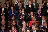 Sen Marco Rubio stands and gives applause as he listens to US President Barack Obama deliver the State of the Union speech in the House chamber of...