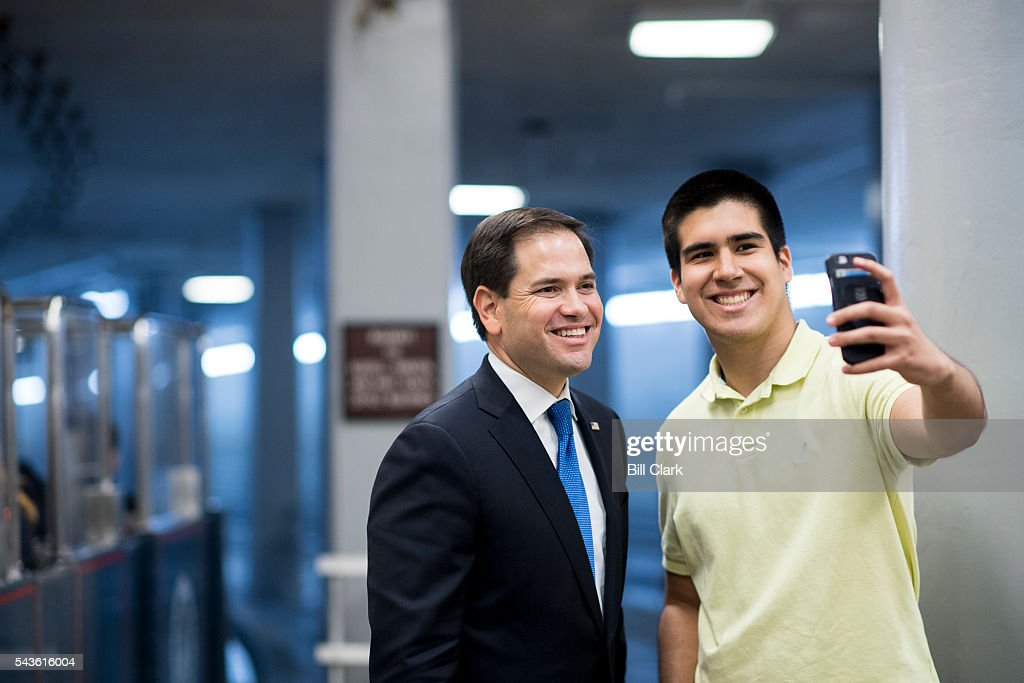 Sen. Marco Rubio (R-FL) stops for a selfie with a man, who did not wish to give his name, in the Senate subway on Wednesday, June 29, 2016.