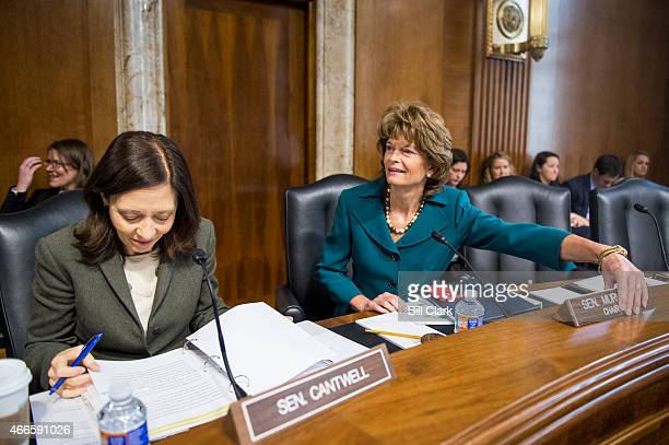 Sen Maria Cantwell DWash left and chairman Lisa Murkowski RAlaska take their seats for the Senate Energy and Natural Resources Committee hearing on...