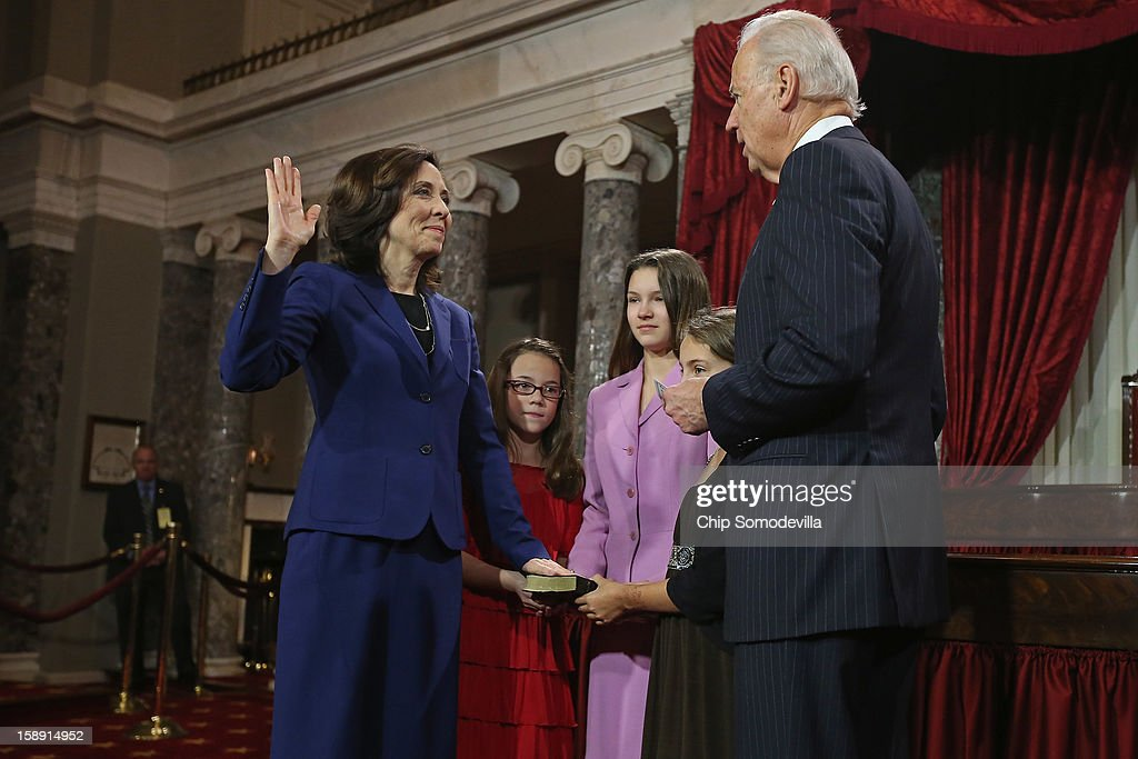 U.S. Sen. Maria Cantwell (D-WA) (L) participates in a reenacted swearing-in with her nieces Kendle Clauser, Crystin Clauser and Zoe Furland and U.S. Vice President Joe Biden in the Old Senate Chamber at the U.S. Capitol January 3, 2013 in Washington, DC. Biden swore in the newly-elected and re-elected senators earlier in the day on the floor of the current Senate chamber.