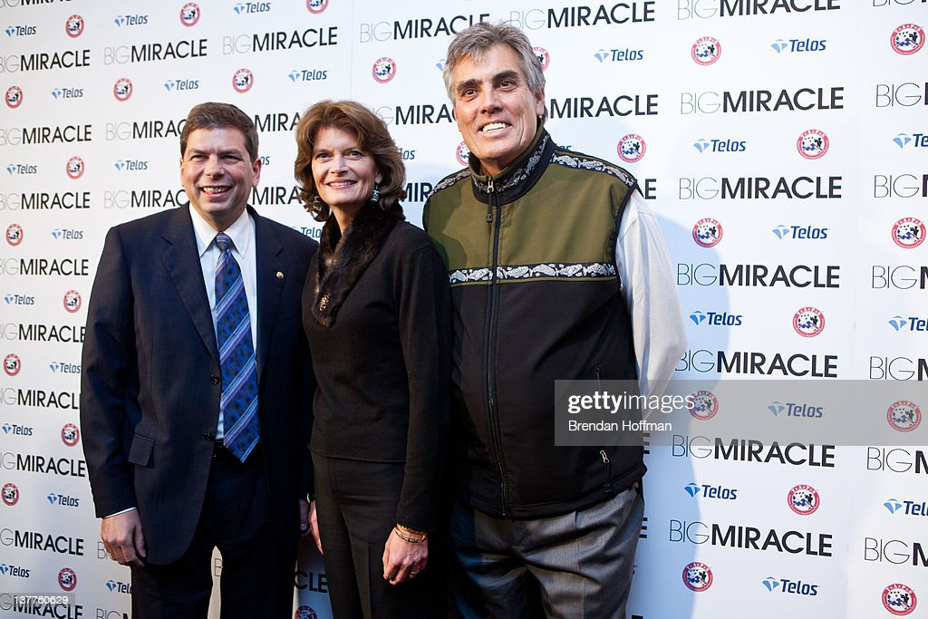 Sen Mark Begich Sen Lisa Murkowski and Murkowski's husband Verne Martell pose for pictures at the Washington DC screening of 'Big Miracle' on January...