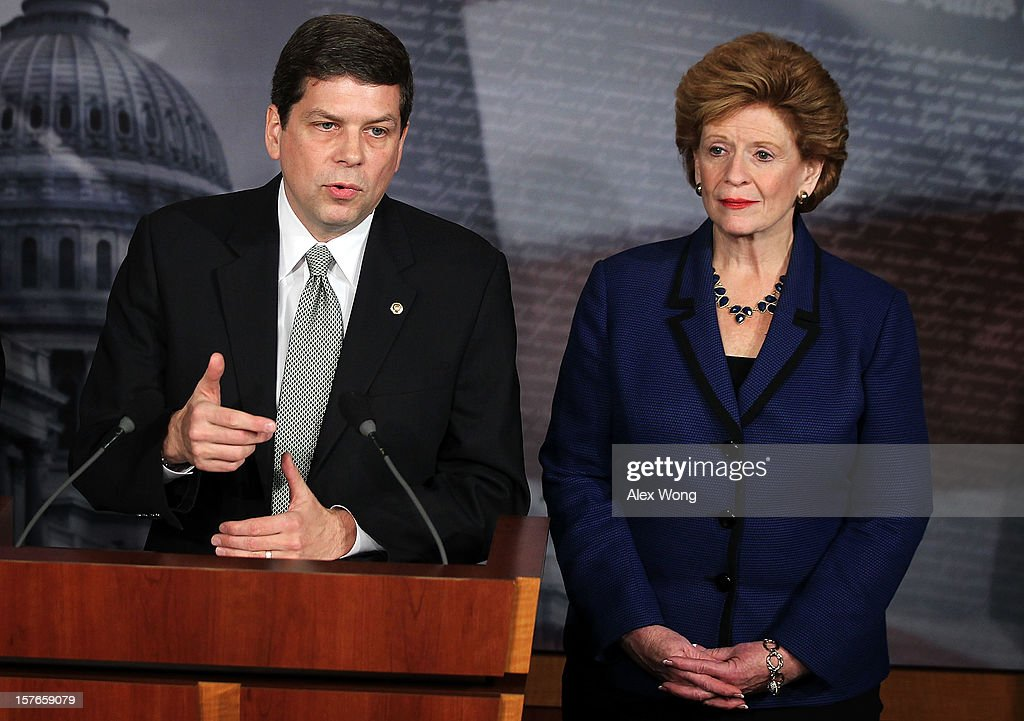 U.S. Sen. <a gi-track='captionPersonalityLinkClicked' href=/galleries/search?phrase=Mark+Begich&family=editorial&specificpeople=5592439 ng-click='$event.stopPropagation()'>Mark Begich</a> (D-AK) (L) speaks as Sen. <a gi-track='captionPersonalityLinkClicked' href=/galleries/search?phrase=Debbie+Stabenow&family=editorial&specificpeople=221624 ng-click='$event.stopPropagation()'>Debbie Stabenow</a> (D-MI) listens during a news conference December 5, 2012 on Capitol Hill in Washington, DC. The senators held a news conference to call on House Republicans to pass the Senate-passed tax cut bill.
