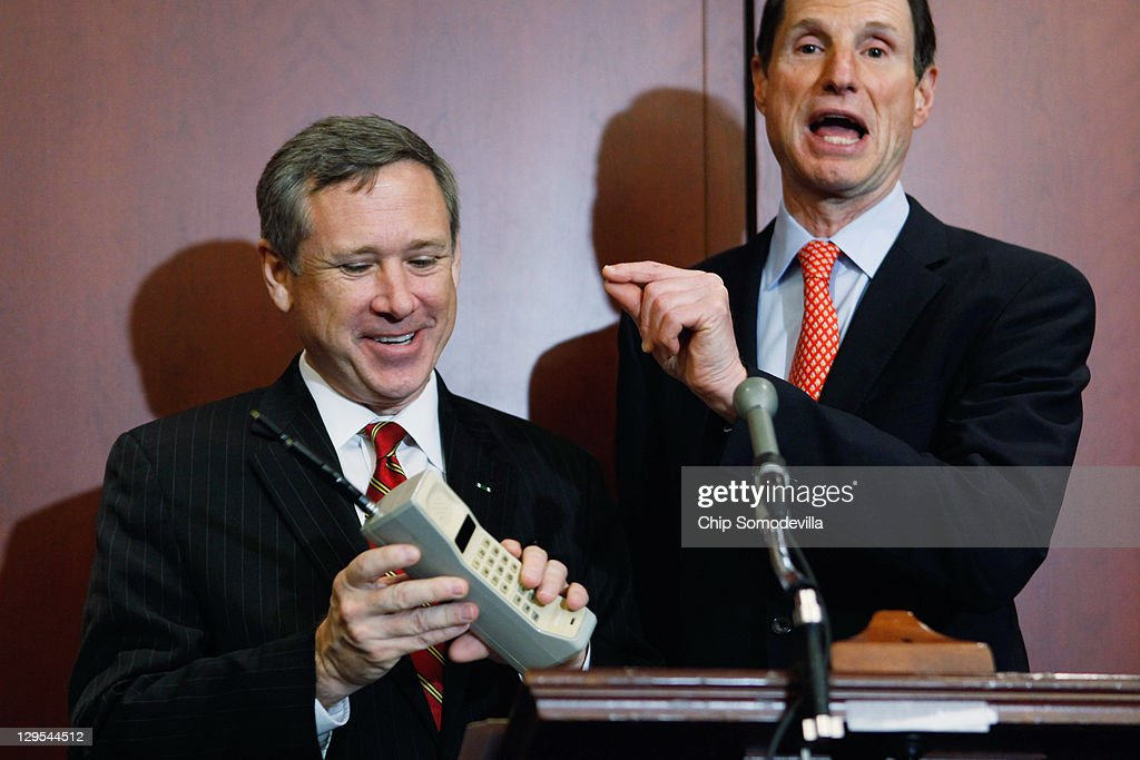 U.S. Sen. <a gi-track='captionPersonalityLinkClicked' href=/galleries/search?phrase=Mark+Kirk&family=editorial&specificpeople=2707485 ng-click='$event.stopPropagation()'>Mark Kirk</a> (R-IL) (L) holds a Motorola cell phone from the 1980s during a news conference with U.S. Sen. <a gi-track='captionPersonalityLinkClicked' href=/galleries/search?phrase=Ron+Wyden&family=editorial&specificpeople=233819 ng-click='$event.stopPropagation()'>Ron Wyden</a> (D-OR) about the 25th anniversary of the Electronic Communications Privacy Act (ECPA) October 18, 2011 in Washington, DC. Wyden and U.S. Sen. <a gi-track='captionPersonalityLinkClicked' href=/galleries/search?phrase=Mark+Kirk&family=editorial&specificpeople=2707485 ng-click='$event.stopPropagation()'>Mark Kirk</a> (R-IL) called for the ECPA legislation to be updated so to ensure that the government must get a warrant from a judge before tracking our movements or reading our private communications.