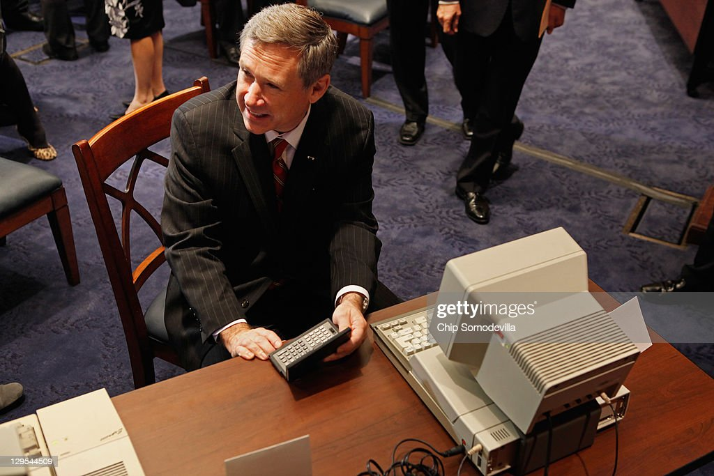 U.S. Sen. <a gi-track='captionPersonalityLinkClicked' href=/galleries/search?phrase=Mark+Kirk&family=editorial&specificpeople=2707485 ng-click='$event.stopPropagation()'>Mark Kirk</a> (R-IL) looks at at Tandy hand-held PC-5 and a IBM PC Convertable before a news conference about the 25th anniversary of the Electronic Communications Privacy Act (ECPA) October 18, 2011 in Washington, DC. U.S. Sen. Krick and U.S. Sen. Ron Wyden (D-OR) called for the ECPA legislation to be updated so to ensure that the government must get a warrant from a judge before tracking our movements or reading our private communications.