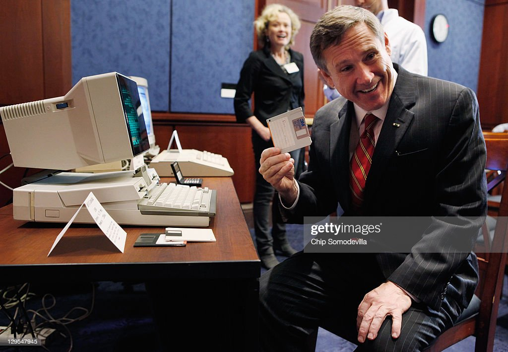 U.S. Sen. <a gi-track='captionPersonalityLinkClicked' href=/galleries/search?phrase=Mark+Kirk&family=editorial&specificpeople=2707485 ng-click='$event.stopPropagation()'>Mark Kirk</a> (R-IL) pulls a 3.5-inch floppy disc from a IBM PC Convertable before a news conference about the 25th anniversary of the Electronic Communications Privacy Act (ECPA) October 18, 2011 in Washington, DC. U.S. Sen. Krick and U.S. Sen. Ron Wyden (D-OR) called for the ECPA legislation to be updated so to ensure that the government must get a warrant from a judge before tracking our movements or reading our private communications.