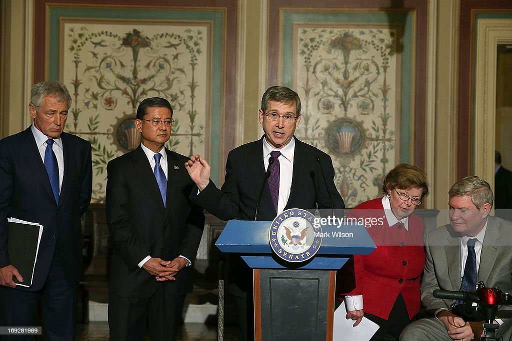 Sen. Mark Kirk (R-IL) (C) speaks while flanked by VA Secretary Eric Shinseki (2nd-L) Defense Secretary Chuck Hagel (L), Senate Appropriations Chairwoman Barbara Mikulski (D-MD) (2nd-R) and Tim Johnson (D-SD) (R) during a news conference on Capitol Hill May 22, 2013 in Washington DC. The news conference was held to provide an update on efforts to eliminate the Veterans Affairs Department claims backlog.