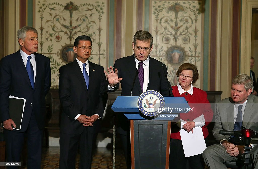 Sen. Mark Kirk (R-IL) (C) speaks while flanked by VA Secretary Eric Shinseki (2nd-L) Defense Secretary Chuck Hagel (L), Senate Appropriations Chairwoman Barbara Mikulski (D-MD) (2nd-R) and Sen. Tim Johnson (D-SD) (R) during a news conference on Capitol Hill May 22, 2013 in Washington DC. The news conference was held to provide an update on efforts to eliminate the Veterans Affairs Department claims backlog.