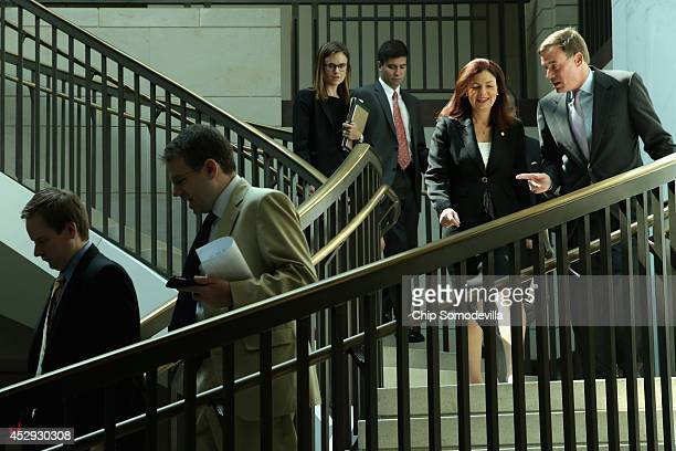 Sen Mark Warner and Sen Kelly Ayotte head to a news conference about new legislation aimed at curbing sexual assults on college and university...