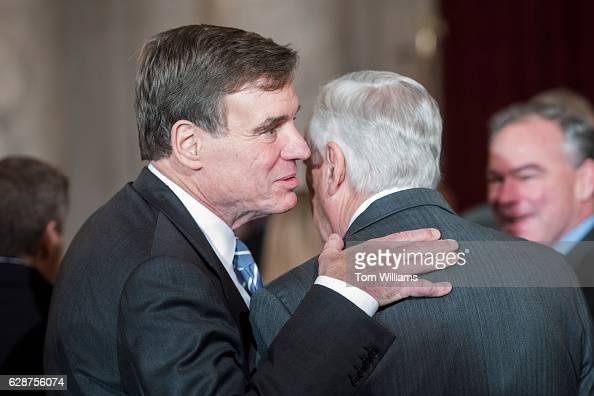 Sen Mark Warner DVa left and House Minority Whip Steny Hoyer DMd attend a portrait unveiling ceremony for retiring Senate Minority Leader Harry Reid...