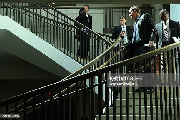 Sen Mark Warner heads to a news conference about new legislation aimed at curbing sexual assults on college and university campuses at the US Capitol...
