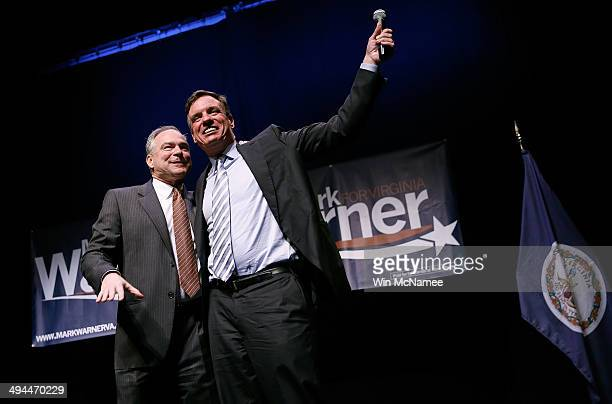 Sen Mark Warner is introduced by Sen Tim Kaine during Warner's reelection kickoff rally May 29 2014 in Arlington Virginia Warner is likely to face...