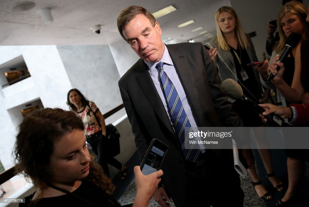 Sen. Mark Warner (D-VA), ranking member of the Senate Select Committee on Intelligence, finishes speaking with reporters before a closed committee meeting July 11, 2017 in Washington, DC. Warner commented briefly on recent reports of Donald Trump Jr. meeting with a Russian lawyer in June 2016.