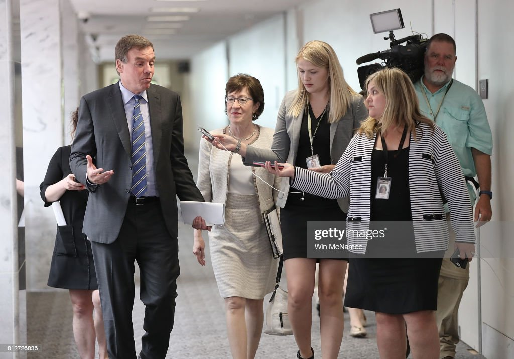 Sen. Mark Warner (L) (D-VA), ranking member of the Senate Select Committee on Intelligence, speaks with reporters while walking with Sen. Susan Collins (R-ME) before a closed committee meeting July 11, 2017 in Washington, DC. Warner commented briefly on recent reports of Donald Trump Jr. meeting with a Russian lawyer in June 2016.