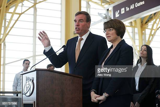 S Sen Mark Warner speaks as Sen Amy Klobuchar and Michelle Guelbart director of private sector engagement at End Child Prostitution and Trafficking...
