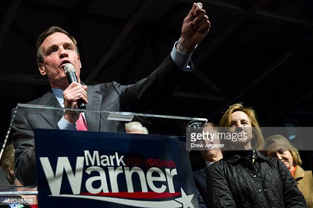 S Sen Mark Warner speaks during a Get Out the Vote rally for Democratic candidates November 3 2014 in Alexandria Virginia Warner the Democratic...