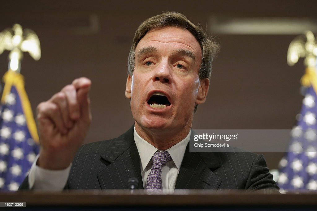 Sen. <a gi-track='captionPersonalityLinkClicked' href=/galleries/search?phrase=Mark+Warner&family=editorial&specificpeople=2251151 ng-click='$event.stopPropagation()'>Mark Warner</a> (D-VA) speaks during a news conference to highlight the impact of the federal government partial shutdown on government workers in the National Capital Region and across the country in the Dirksen Senate Office Building on Capitol Hill October 2, 2013 in Washington, DC. Hundreds of thousands of 'non-essential' federal employees across the country were furloughed after House Repulicans and Senate Democrats couldn't settle on a budget and the government shut down for the first time in 17 years.