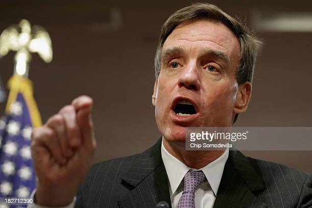 Sen Mark Warner speaks during a news conference to highlight the impact of the federal government partial shutdown on government workers in the...