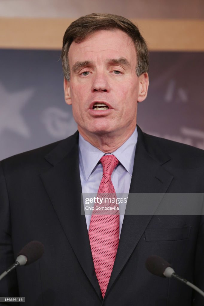 Sen. <a gi-track='captionPersonalityLinkClicked' href=/galleries/search?phrase=Mark+Warner&family=editorial&specificpeople=2251151 ng-click='$event.stopPropagation()'>Mark Warner</a> (D-VA) speaks during a news conference to outline the economic damages caused by the federal shutdown at the U.S. Capitol October 31, 2013 in Washington, DC. Warner and a group of fellow Democratic senators issued a report highlighting the the affects the 16-day federal shutdown and how it cost jobs and hurt business across the country.