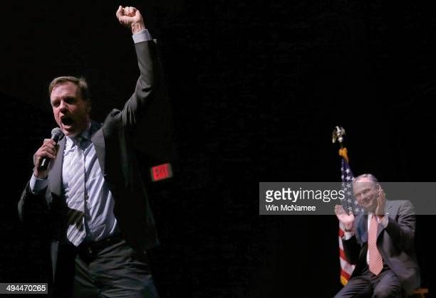 Sen Mark Warner speaks during his reelection kickoff rally after being introduced by Sen Tim Kaine May 29 2014 in Arlington Virginia Warner is likely...
