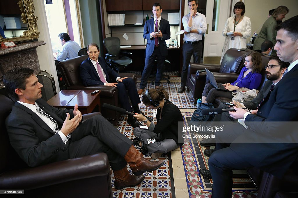 Sen. <a gi-track='captionPersonalityLinkClicked' href=/galleries/search?phrase=Martin+Heinrich&family=editorial&specificpeople=5592274 ng-click='$event.stopPropagation()'>Martin Heinrich</a> (D-NM) (L) and Sen. <a gi-track='captionPersonalityLinkClicked' href=/galleries/search?phrase=Ron+Wyden&family=editorial&specificpeople=233819 ng-click='$event.stopPropagation()'>Ron Wyden</a> (D-OR) talk with reporters after the passage of the USA FREEDOM Act at the U.S. Capitol June 2, 2015 in Washington, DC. Reforming how American intelligence agencies collect citizens' phone information, the legislation passed the Senate 67-32 and will go to President Barack Obama for his signature.