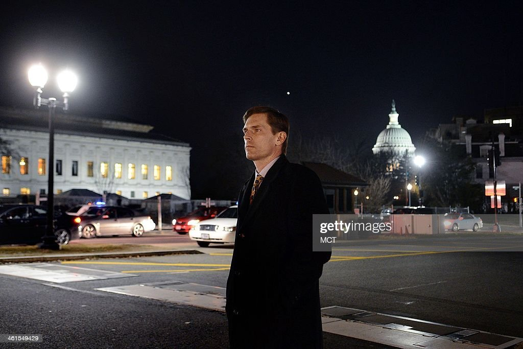 Sen. Martin Heinrich (D-N.M.), the junior senator from New Mexico and newest member of the U.S. Senate Select Committee on Intelligence, looks for a taxi while leaving Capitol Hill, Dec. 18, 2013 in Washington, D.C.