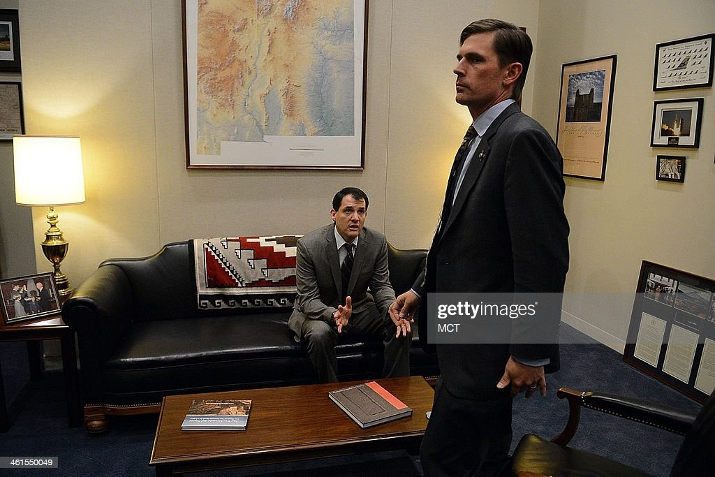 Sen. Martin Heinrich (D-N.M.), the newest member of the U.S. Senate Select Committee on Intelligence, talks to his chief of staff Steve Haro, inside his office on Capitol Hill in Washington, D.C., Dec. 18, 2013.