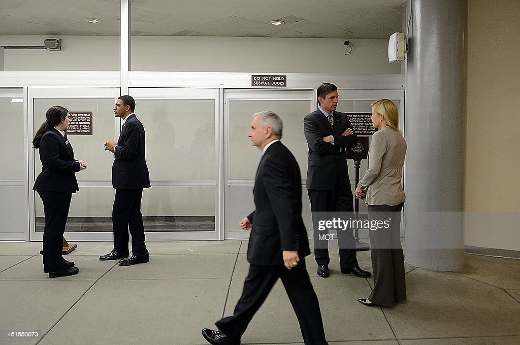 Sen. Martin Heinrich (D-N.M.), the newest member of the U.S. Senate Select Committee on Intelligence, waits for the subway while on his way back to his office after voting on the Senate floor on the budget bill on Capitol Hill in Washington, D.C., Dec. 18, 2013.