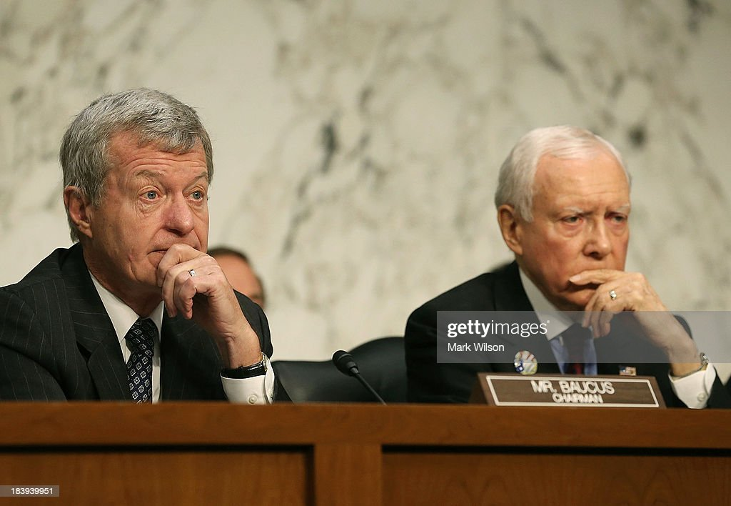 Sen. <a gi-track='captionPersonalityLinkClicked' href=/galleries/search?phrase=Max+Baucus&family=editorial&specificpeople=242972 ng-click='$event.stopPropagation()'>Max Baucus</a> (D-MT) (L) and Sen. Orin Hatch (R-UT) listen to Treasury Secretary Jack Lew speak during a Senate Finance Committee hearing on Capitol Hill, October 10, 2013 in Washington, DC. The committee is hearing testimony from Secretary Lew on the nations debt limit.