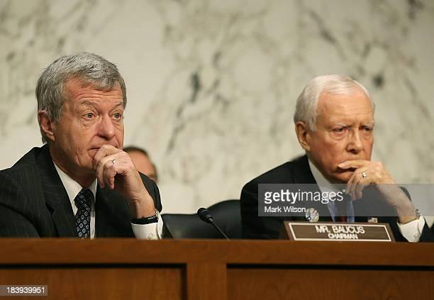 Sen Max Baucus and Sen Orin Hatch listen to Treasury Secretary Jack Lew speak during a Senate Finance Committee hearing on Capitol Hill October 10...
