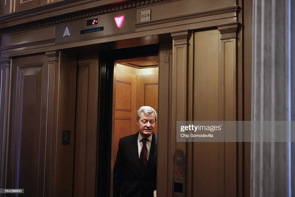 U.S. Sen. <a gi-track='captionPersonalityLinkClicked' href=/galleries/search?phrase=Max+Baucus&family=editorial&specificpeople=242972 ng-click='$event.stopPropagation()'>Max Baucus</a> (D-MT) boards an elevator after voting on a series of amendments to the Senate's budget legislation at the U.S. Capitol March 22, 2013 in Washington, DC. The Senate is debating federal budget legislation, the first time it has put forward a budget in four years.