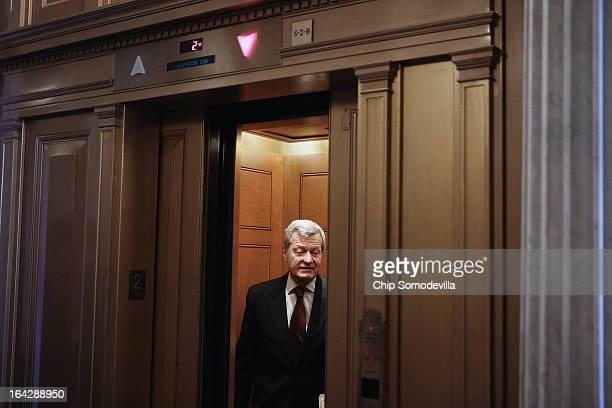 S Sen Max Baucus boards an elevator after voting on a series of amendments to the Senate's budget legislation at the US Capitol March 22 2013 in...